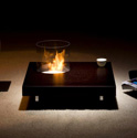 A more traditional coffee table with smokeless biofire designed by Planika Studio.